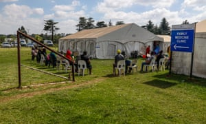 Patients wait outside of a medical tent at the Tembisa Hospital in Tembisa, on March 1, 2021.