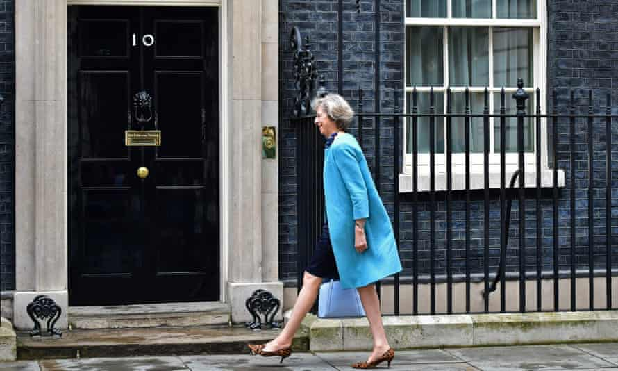 Theresa May arrives to attend a cabinet meeting at 10 Downing Street.