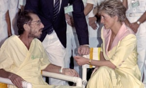 Diana, Princess of Wales, in April 1991 talking with a man infected with the Aids virus during a visit to a hospital in Rio de Janeiro