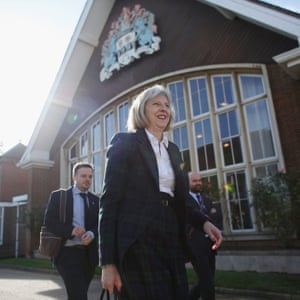 Theresa May leaves after addressing The College of Policing Conference in Bramshill near Hook, Hampshire.