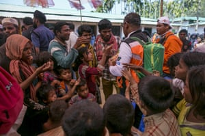 The crew distributes sweets in Chittagong