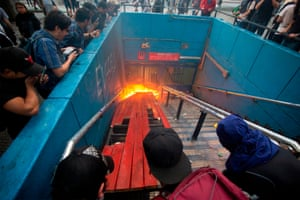 Protesters burn an entrance to Santa Lucía metro station in Santiago