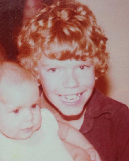 James O'Brien, aged 9 or 10, with the baby of a family friend