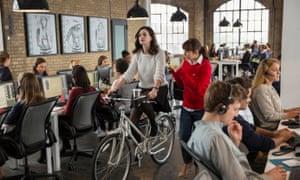 Anne Hathaway riding bike through office in The Intern
