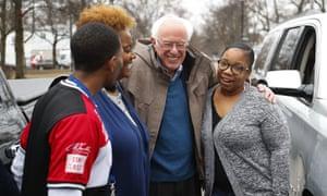 Sanders visits custodian Davonta Bynes, from left, principal DaRhonda Evans-Stewart and social worker Kim Little outside a polling location in Detroit.