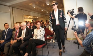 Milo Yiannopoulos enters beside the One Nation-filled front row.
