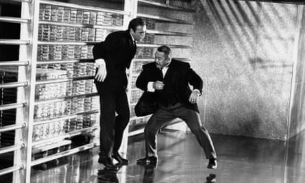 Goldfinger: Sean Connery as James Bond fights with Harold Sakata's Oddjob the bullion in Fort Knox's gold depository.