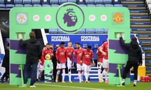 The Manchester United players take to the pitch.
