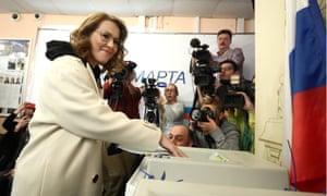 Presidential candidate Ksenia Sobchak casts her ballot.