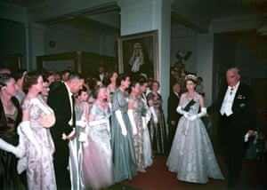 Robert Menzies accompanies the Queen as she passes lines of guests at a ball at Parliament House in 1954