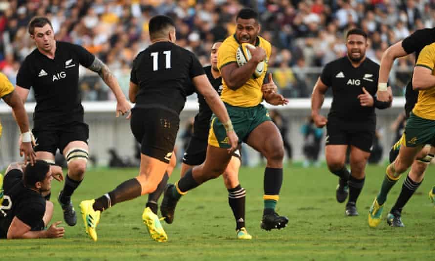Australia's Samu Kerevi runs past New Zealand's wing Rieko Ioane during the Bledisloe Cup rugby union Test at Yokohama International stadium.