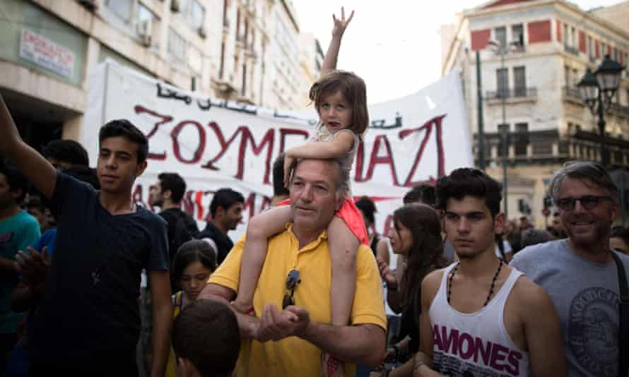People demonstrate in support of refugees in Athens on Thursday.