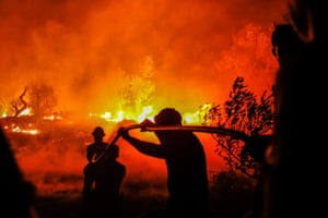 Firefighters tackle a forest fire in Corgos near Silves