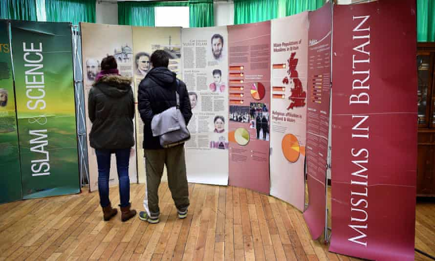 Visitors read information boards during an open day at Finsbury Park mosque in London.