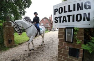 Sophie Allison on Splash leaves the stables at Three Oaks in Bramshill, Hampshire, which is being used a polling station.