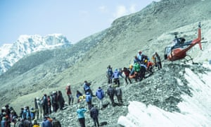 A rescue helicopter returns to Everest base camp after the 2014 avalanche