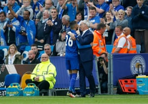 Cheers all around as Leicester manager Claudio Ranieri hugs Riyad Mahrez as he is substituted.