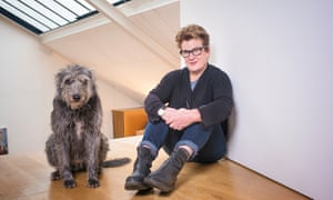 Meg Rosoff at home with one of her dogs