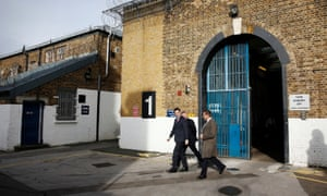 "George Osborne (centre) and Michael Gove (left) are shown around the exercise yard outside ""A"" Wing of HM Prison Brixton"