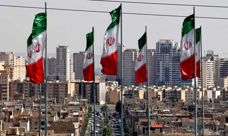 Four Iranians, one an intelligence officer, have been charged by the US justice department of conspiring to kidnap a New York journalist.