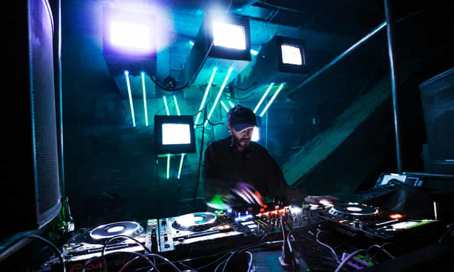 DJ at the decks at Khidi, a nightclub in a former industrial space in Tbilisi, Georgia.