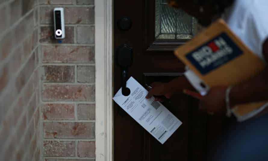 Cynthia Ginyard leaves a registration form on someone's door.