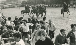 Police officers mount a charge against picketing miners, in what became known as the 'Battle of Orgreave' in June 1984.