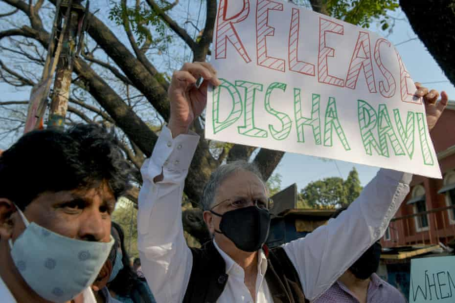Historian, author and activist Ramachandra Guha (right) protests against the arrest of the activist Disha Ravi by Delhi police