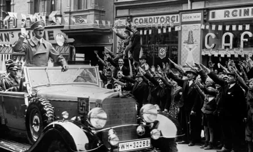 Adolf Hitler at the head of a convoy through Sudetenland, October 1938.