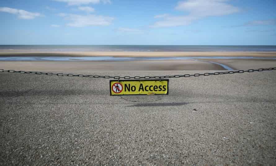 Covid warnings on a Blackpool beach