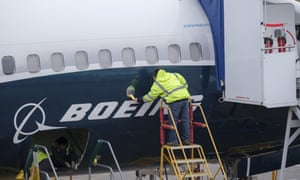 Boeing employees work on a 737 Max aircraft at the company's factory in Renton, Washington.