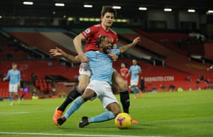 Raheem Sterling goes down under pressure from Harry Maguire.