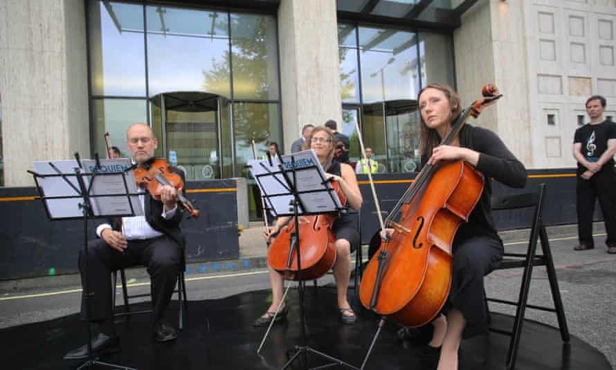 A string quartet performs the 'Requiem for Arctic ice' as part of Greenpeace's month-long run of Titanic-themed orchestral protests against Arctic drilling outside Shell's offices on the South Bank, London.