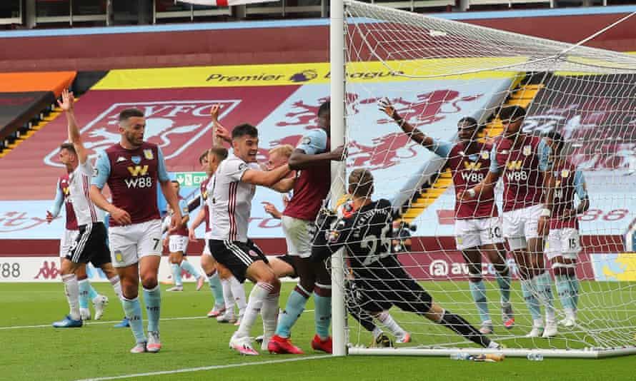 Aston Villa's Ørjan Nyland holds the ball behind the line but Sheffield United are denied a goal as the goalline technology fails