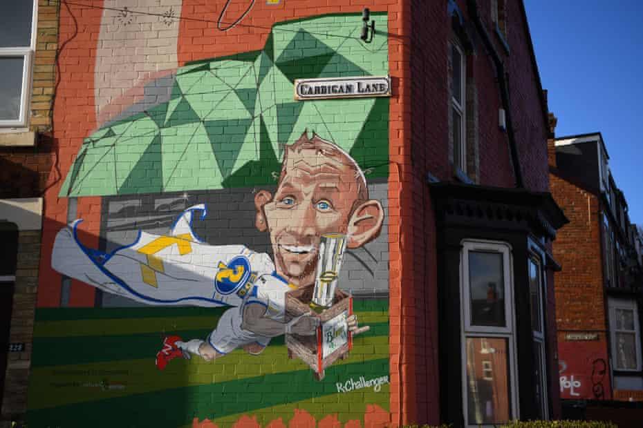 A mural depicting Rob Burrow is seen near the Emerald Headingley Stadium.