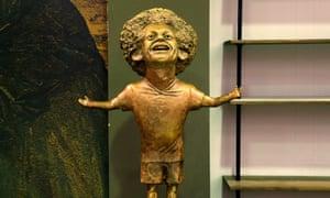 Mai Abdallah's statue of Liverpool's Egyptian forward Mohamed Salah. Or Art Garfunkel. Or Leo Sayer. Or Marv from Home Alone.