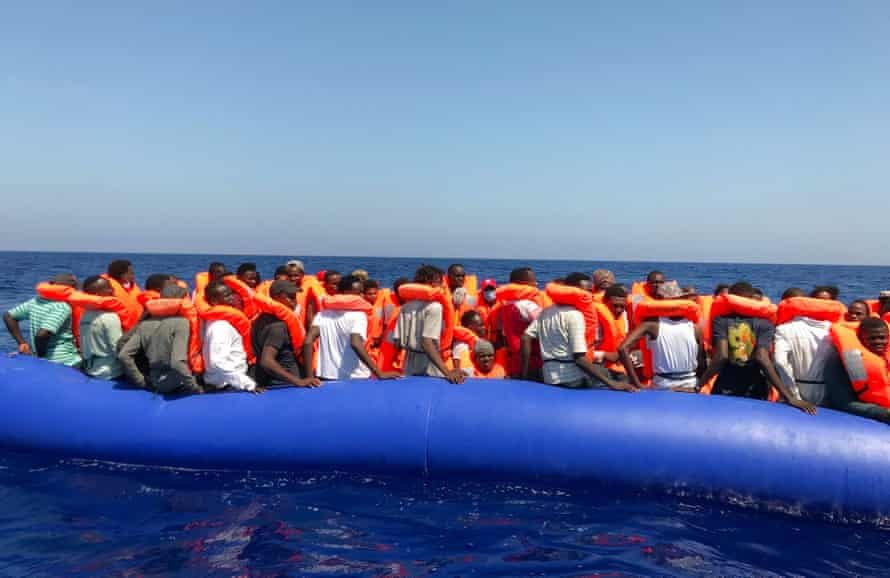 Migrants being rescued on an inflatable dinghy belonging to the 'Ocean Viking' rescue ship, operated by French NGOs SOS Mediterranee and Medecins sans Frontieres (MSF) in the Mediterranean Sea last summer.