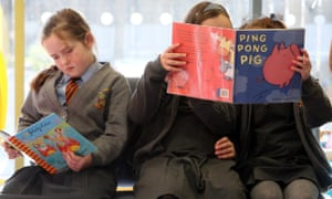 Children read books at primary school