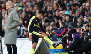 Alexis Sánchez shows his displeasure at being substituted by Arsène Wenger before covering his face on the Arsenal bench.