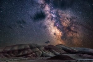 Painted HillsNicholas Roemmelt (Germany) With very little light pollution, the glimmering stars of the Milky Way bathe the colourful layers of the Painted Hills of Oregon in a natural glow.