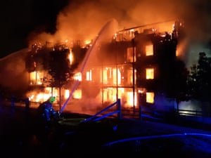 A block of flats on fire in London, England