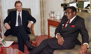 Tony Blair led the call to suspend Zimbabwe from the Commonwealth in 2002. Robert Mugabe, right, never forgave him.