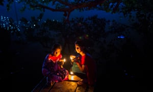 'There is a sweetness in the way we shape our lives around light' ... two girls celebrate Diwali in Bangladesh.