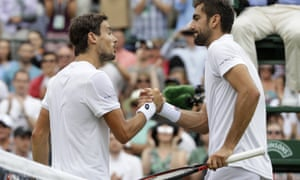 Guido Pella of Argentina, left, shakes with Marin Cilic after defeating him in their match which was resumed after being suspended on Wednesday.