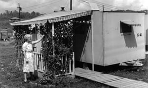 Trailer with decorative trellis, Oak Ridge, 1944. Residents of the Manhattan Project sites worked hard to make their dwellings as attractive and pleasant as possible, even when those dwellings were crude, government-issued trailers. Note the identifying numbers stamped and written on the side of the trailer.