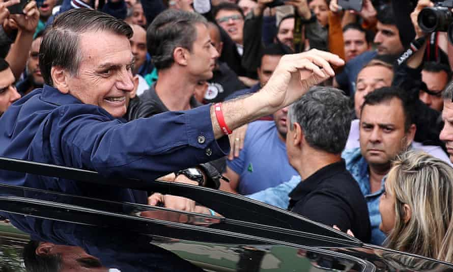 Jair Bolsonaro presidential candidate of the Social Liberal party (PSL), gestures after casting his vote in Rio de Janeiro
