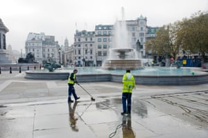Cleaners work in an empty Trafalgar square on the first day of the second lockdown in England.