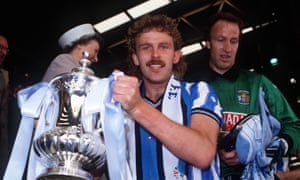 Coventry's captain Brian Kilcline holds the FA Cup in 1987 after a 3-2 victory against Tottenham Hotspur after extra time.