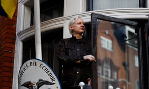 Julian Assange is seen on the balcony of the Ecuadorian embassy in London on 19 May.