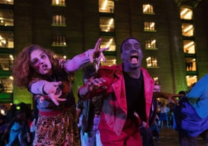 Professional dancers dressed as zombies perform Michael Jackson's Thriller